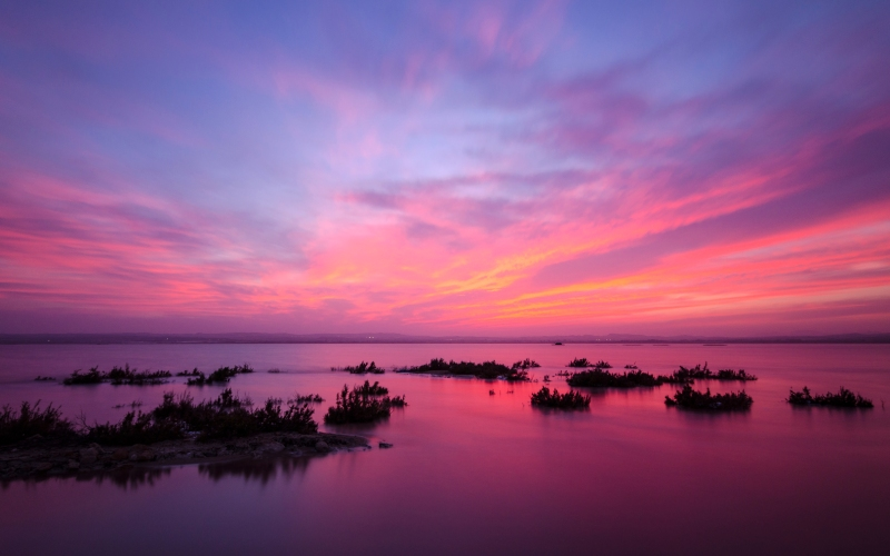 Un lieu offrant une vue panoramique unique au coucher du soleil