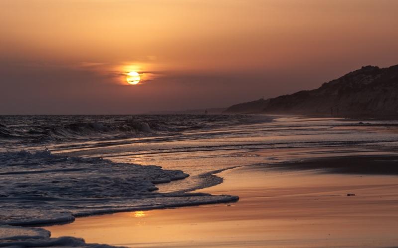 Coucher de soleil sur la plage de Doñana